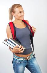 Cute student girl holding books