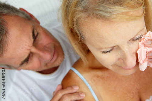 Man comforting crying wife