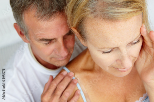 Man comforting distressed wife