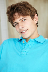 Portrait teenage boy at home