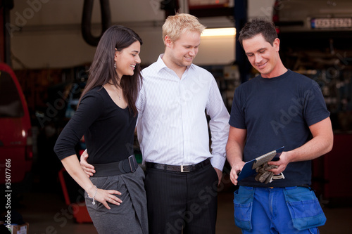 Happy Customer Couple with Mechanic