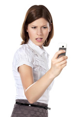 Portrait of a beautiful angry businesswoman holding phone