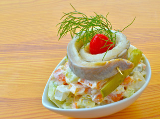 Russian salad with herring