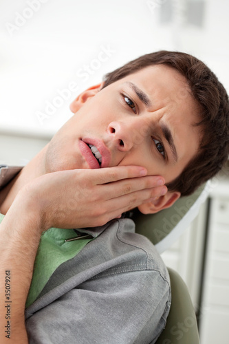 Young man with a toothache