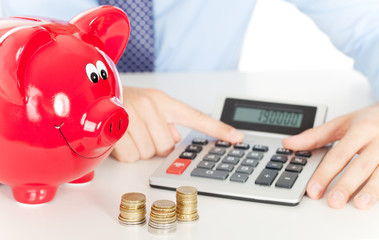 taschenrechner sparschwein münzen