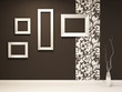 Showroom. Empty frames on the black wall with decoration