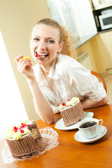 Young woman eating torte at home