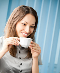 Businesswoman drinking coffee at office