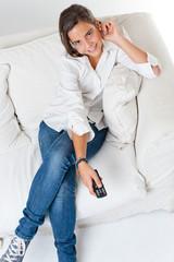 Smiling Teenage girl watching TV