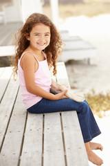 Little girl outdoors holding starfish
