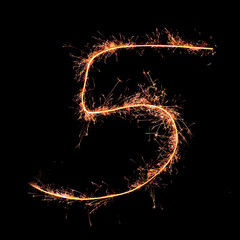 Digit 5 made of sparklers isolated on black
