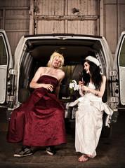 Bride and cross dressing bridesmaid at Hillbilly Wedding