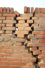 crack of red brick wall