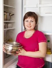woman with near refrigerator