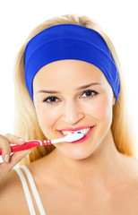 Young happy woman brushing teeth