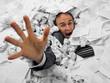 Leinwandbild Motiv Businessman sinking in heap of documents
