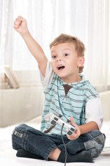Happy child playing a video game