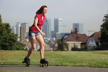 Beautiful woman summer fun roller skating London