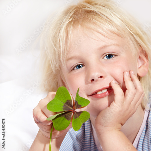 Cute blond girl has luck with shamrock