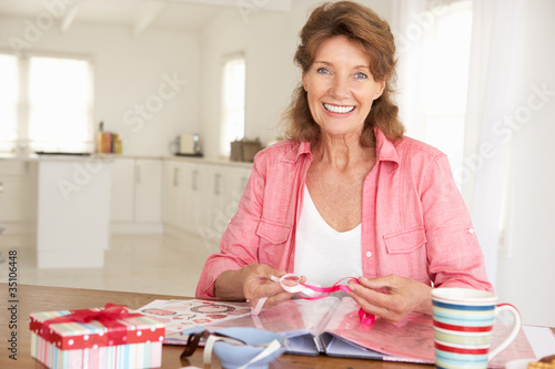 Senior woman scrapbooking