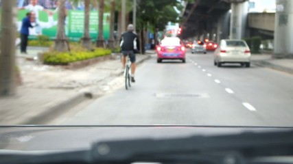 riding bicycle along the road in Bangkok