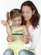 Mother and cute little girl having fun with touchpad