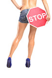 Attractive woman holding a traffic sign stop over her buttock poster
