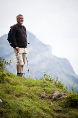 active handsome senior man nordic walking outdoors