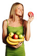 woman holds a pile of fruit