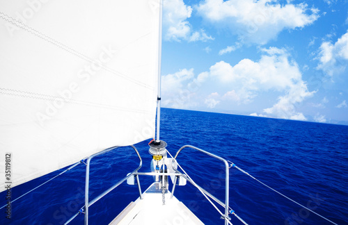 Fotobehang Water Motorsp. White sailboat