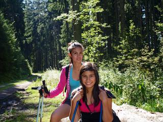 happy teenagers hiking trip