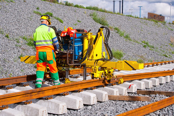 Railroad track installation machine in use