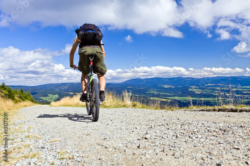 Riding a bike in mountains
