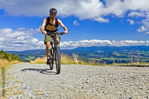 Mountain biker riding a bike