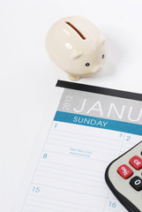 new year calendar and piggy bank