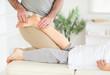 Masseur massaging woman's foot