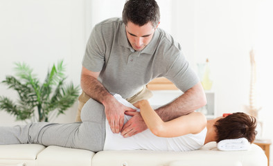 Masseur massaging woman