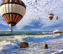 Huge balloons, sea, a spring storm