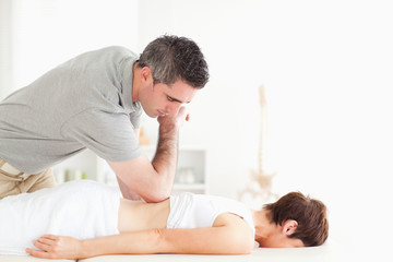 Woman relaxing during a back-massage
