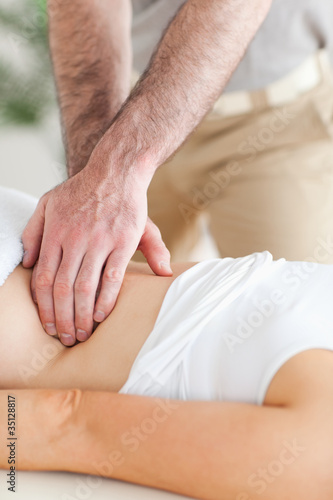Guy massaging a person's back