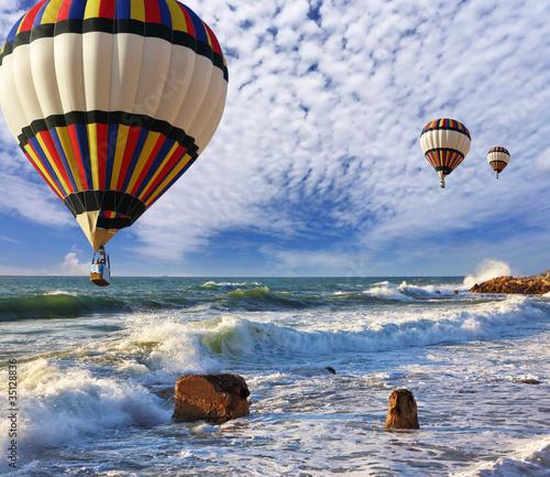 Fotobehang Ballon Huge balloons, sea, a spring storm