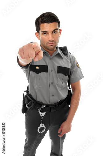 Police officer or prison guard pointing his finger