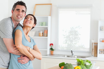 Smiling husband and wife hugging