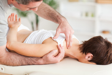 Man massaging a woman's shoulder