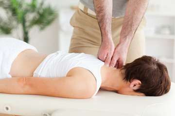 Masseur massaging a customer's neck