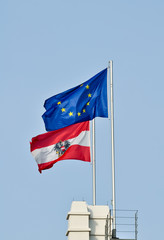 flags of austria and the european union against blue sky