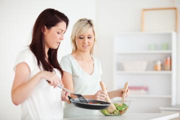Beautiful Women cooking dinner