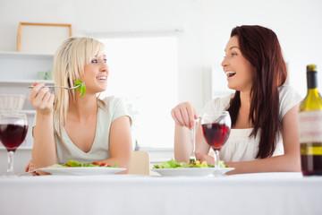 Cute women eating salad