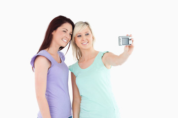 Cheerful women with a camera