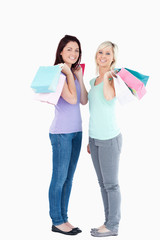 Smiling women with shopping bags